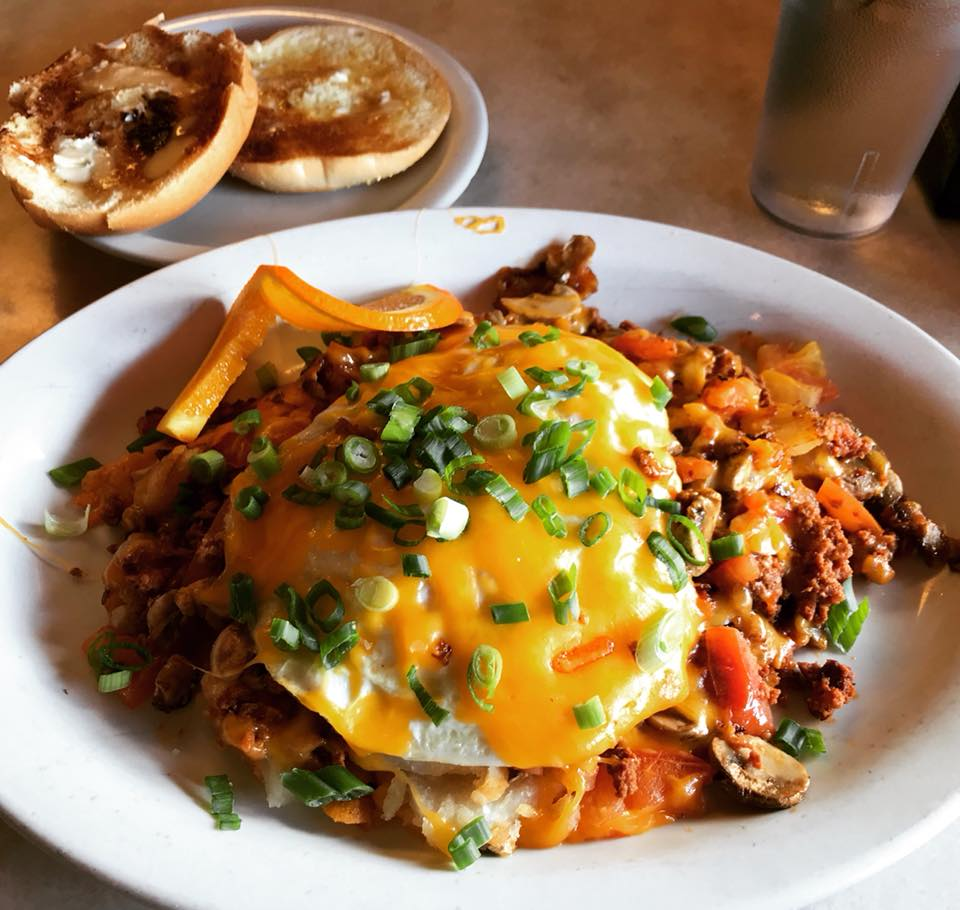 "Wally's ""Country"" Oldie: Chorizo, mushrooms, tomatoes and home fries topped with 2 eggs and melted cheese"